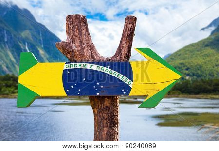 Brazil Flag wooden sign with mountains background