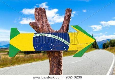 Brazil Flag wooden sign with road background