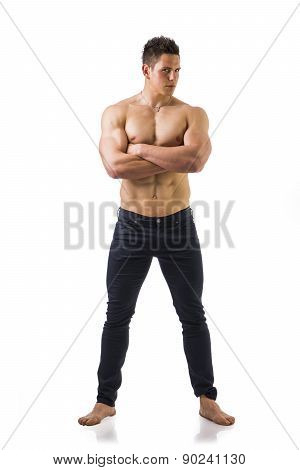 Full length shot of shirtless muscular young man in jeans