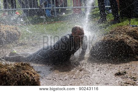Man Laying In The Mud, Squirted With Water