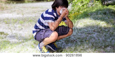 Young Boy With Pollen Allergy With Handkerchief
