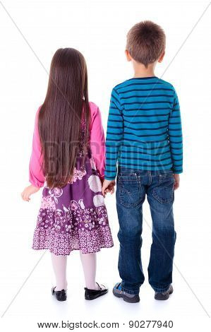 Little Boy And Girl Standing And Looking Towards