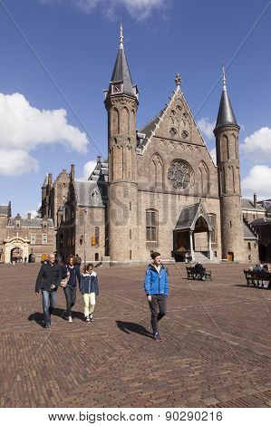 Tourists Walk On Binnenhof In Front Of Ridderzaal In The Hague