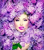 Beauty fashion model Girl with Lilac Flowers Hair Style. Beautiful Model woman lying on Blooming flowers background. Nature Hairstyle. Holiday Creative Violet color Makeup. Purple Make up Vogue Style  poster