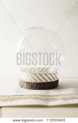 snow globe on cream background