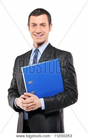 Portrait Of A Happy Businessman Holding A Fascicule