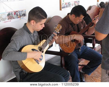 people playing guitar