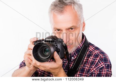 Portrait Of Senior Photographer With Camera In Her Hands