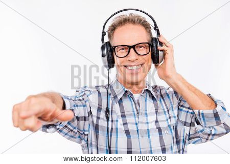 Handsome Man With Beaming Smile And Headphones
