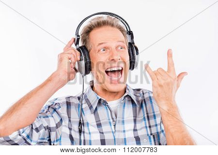Excited Mature Man Listening To Rock Music