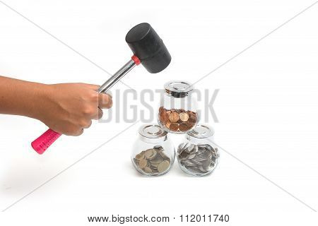 A Hammer About To Smash A Jar Of Money. Suggests Breaking Into Savings Money