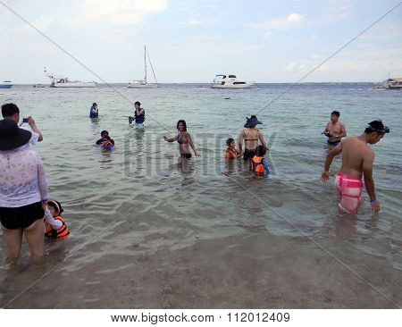 Swimmers at a Beach in the Philippines