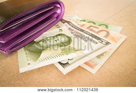 International Currencies Bank Note In The Wallet