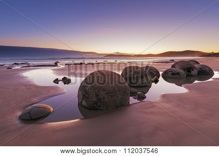 Famous Moeraki Boulders at sunrise Koekohe beachOtago South Island New Zealand poster