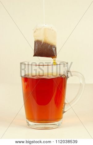 Tea bags over glass with aromatic hot tea