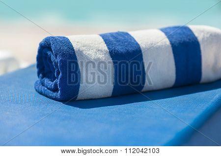 Towel On A Sun Lounger On The Beach