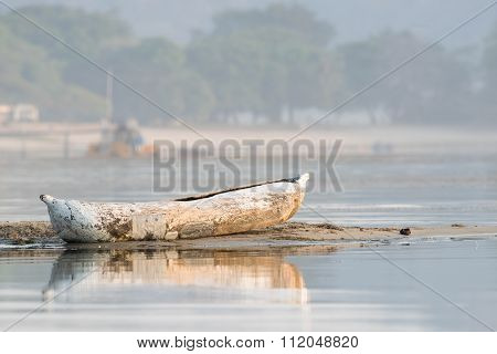 Traditional Dugout Resting On Shore Of Lake Malawi