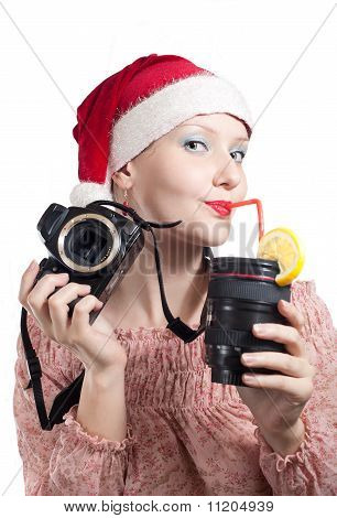 Beautiful Girl Drinking From Lens Cup In Christmas Hat Isolated On White