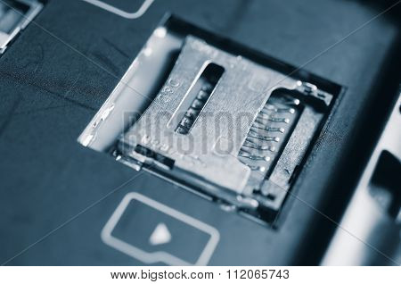 Socket for memory card micro-SD. Metal contacts. Close-up view. Logo memory card. Cool vintage toning. poster