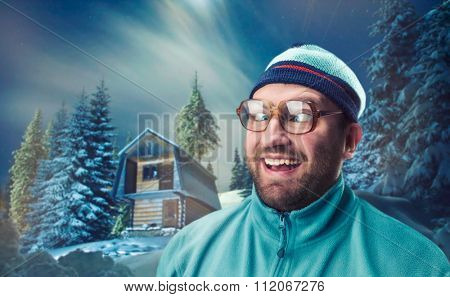 Squint-eyed retro skier in winter mountains at night