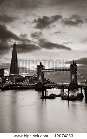 The Shard and Tower Bridge over Thames River in London.
