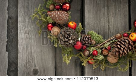 Christmas wreath made of juniper, nuts and cones