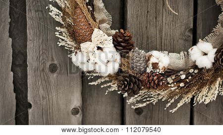 Christmas wreath with pine cones and cotton