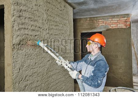 Plasterer operating sprayer equipment machine for spraying thin-layer putty plaster finishing on brick wall  poster