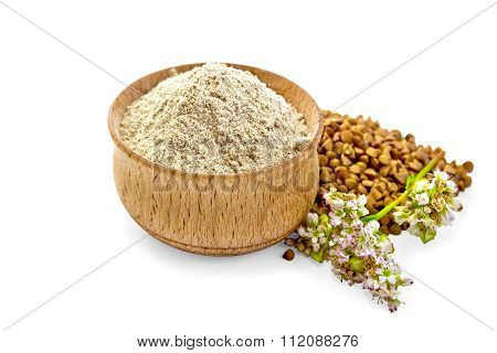 Flour buckwheat in bowl with cereals and flower