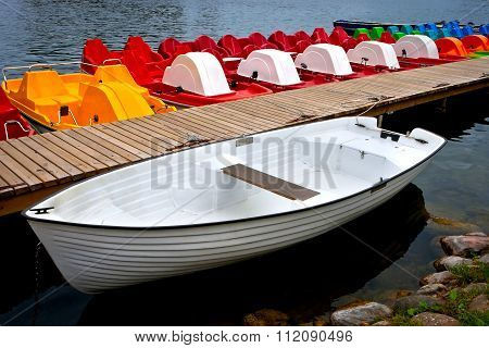 White Boat And Catamarans On Moorage