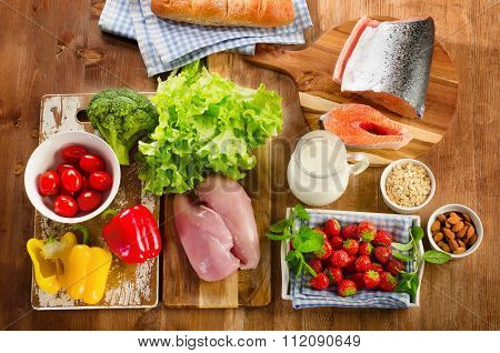 Balanced Diet, Healthy Food Concept On Wooden Board.