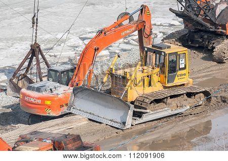 Bulldozer on quay construction site. Tyumen