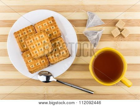 Biscuits Sandwiches, Cup Of Tea, Lumpy Sugar On Striped Table
