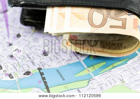European union currency in a wallet and map