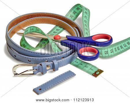 Waist Belt, A Pair Of Scissors And A Tailor's Ruler