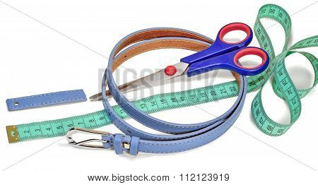 waist belt scissors sartorial ruler and part of the belt isolated on white background poster