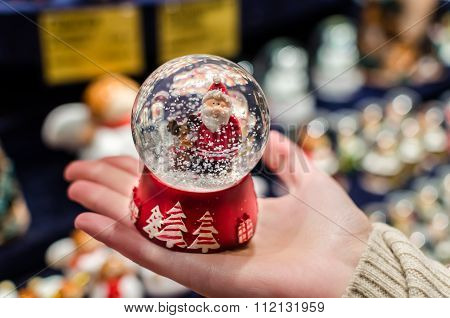 Christmas Snowdome With Santa Claus Inside It On Palm