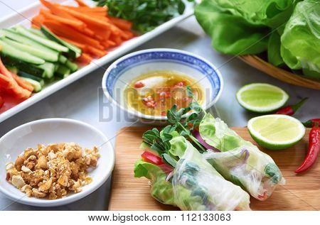 Fresh Vietnamese spring rolls filled with vegetables and herbs, healthy lunch asian meal with dipping sauce