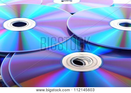 CD or DVD (Compact Discs) laid out on a white background