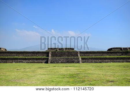 TEOTIHUACAN, MEXICO, OCTOBER 6, 2015: Green Grass Field And Teotihuacan Ruins
