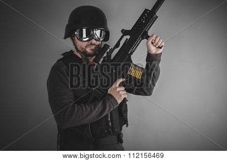 gunpowder, airsoft player with gun, helmet and bulletproof vest on gray background