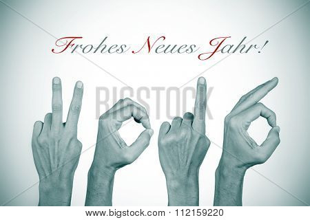 man hands forming the number 2016, as the new year, and the text frohes neues jahr, happy new year in german, in black and white