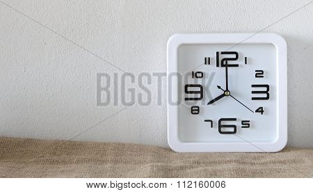 Alarm clock on wood table