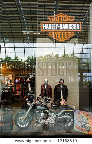 SINGAPORE - NOVEMBER 08, 2015: shopwindow of store with Harley-Davidson clothing. Harley-Davidson, Inc., or Harley, is an American motorcycle manufacturer.