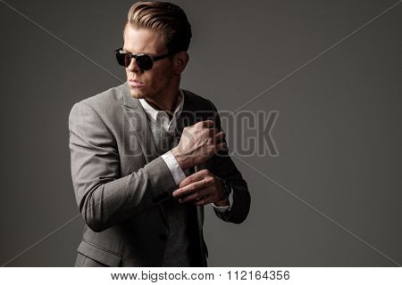 Confident sharp dressed man in grey suit  poster
