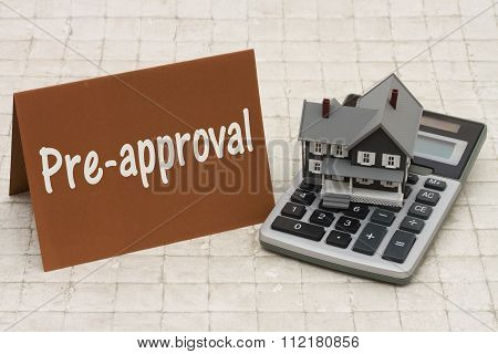 Home Mortgage Pre-approval, A Gray House, Brown Card And Calculator On Stone Background