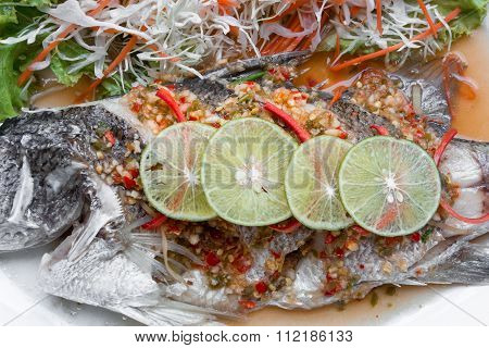 Fish Dish - Steamed Snapper With Lemon On Black Background.