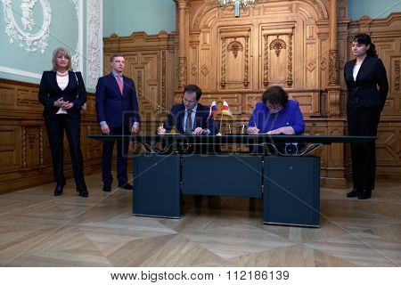 ST. PETERSBURG, RUSSIA - DECEMBER 15, 2015: Russian Minister of culture Vladimir Medinsky and Minister of culture of South Ossetia Madina Ostayeva signs the plan of cooperation during Cultural Forum