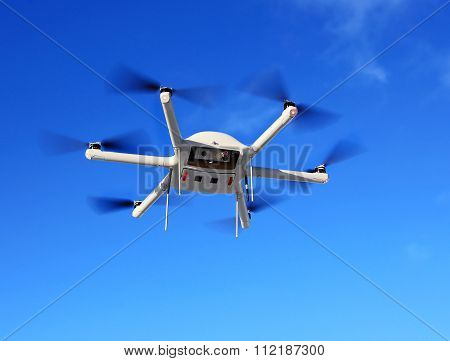 MOSCOW REGION - DECEMBER 17: Quadrocopter - four rotor aerial vehiclerotating in opposite diagonal directions without crew on board. Applicable for air shooting and real-time monitoring of ground objects  on December 17, 2015 in Moscow Region