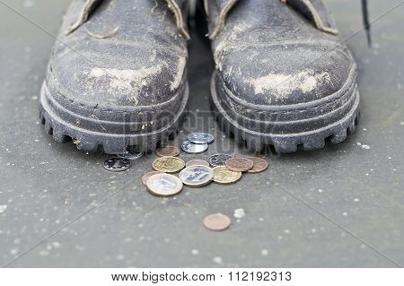 Begger And Coins